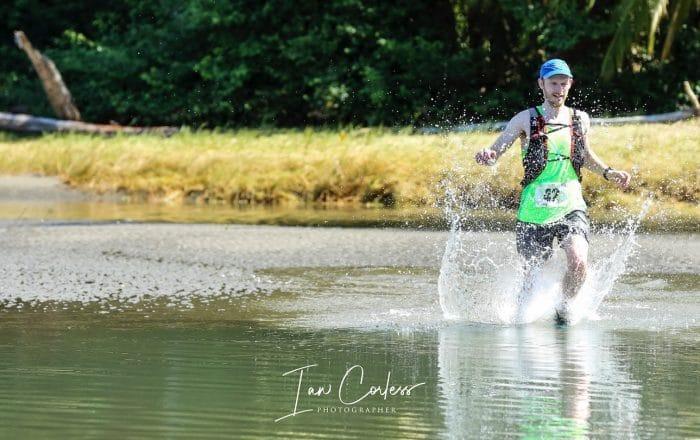 Damian running through water during UTMR