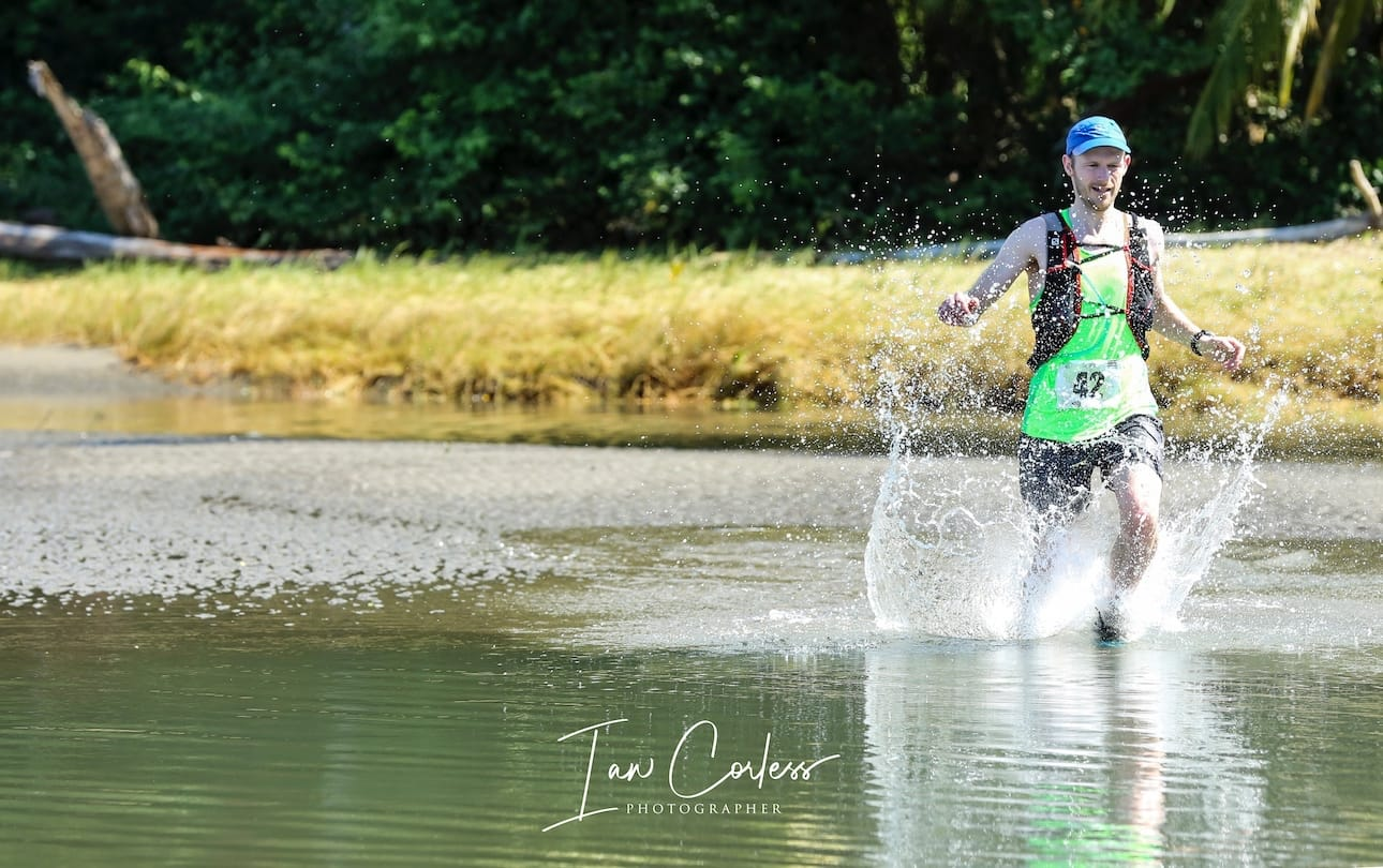 Damian running through water during UTMR