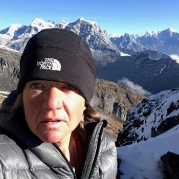 photo of Lizzy Hawker on a mountain backdrop