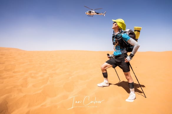 Helicopter passing runner as they take part in MDS