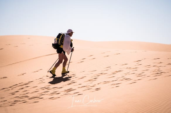 Lone MDS runner running in the desert