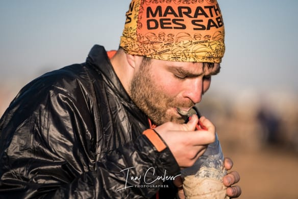 Runner in Marathon Des Sables eating