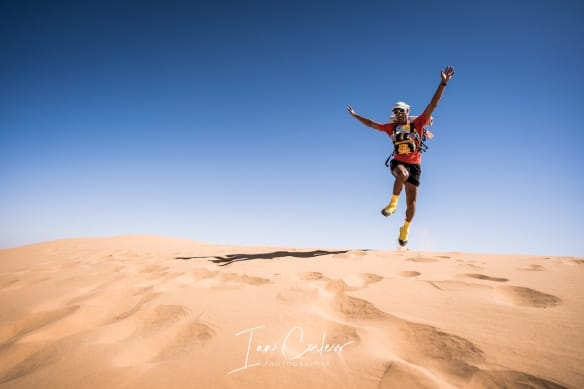 Runner leaping for enjoy at the end of Marathon Des Sables