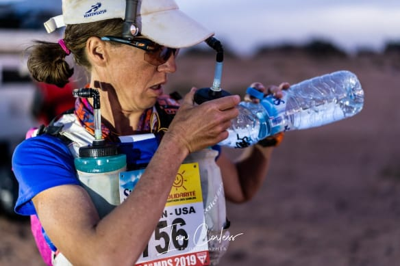A multi-stage runner refilling water bottle