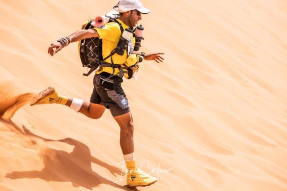 MDS Runner running down a desert dune